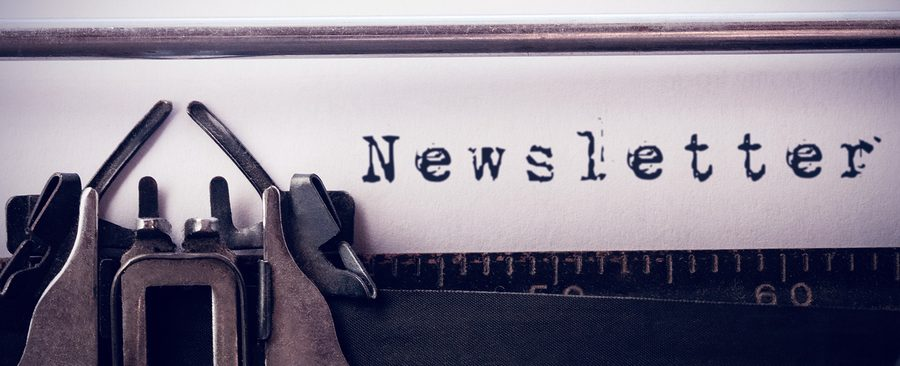The word newsletter against white background against close-up of