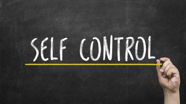 5352641 Self control concept. Hand with yellow marker writing se