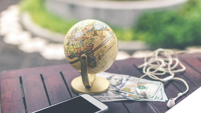 smartphone-beside-mini-desk-globe-1079034