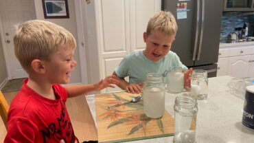 Logan and Nathan Libbrecht at table